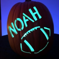 Hand carved custom pumpkin with football
