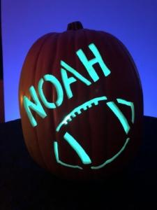 Hand carved custom pumpkin with football