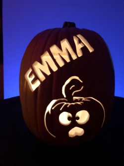 Hand carved custom pumpkin with funny face