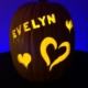 Hand carved custom pumpkin with hearts