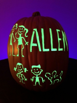 Custom carved Jack O' Lantern with family members - mom, dad, sister, brother and dog