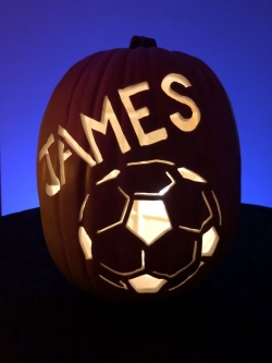 Hand carved custom pumpkin with soccer ball