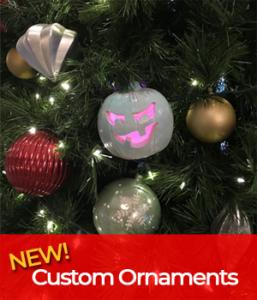 Halloween ornaments hanging on Christimas tree