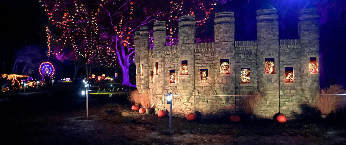 Disney castle and characters on display during Jack O' Lantern Journey