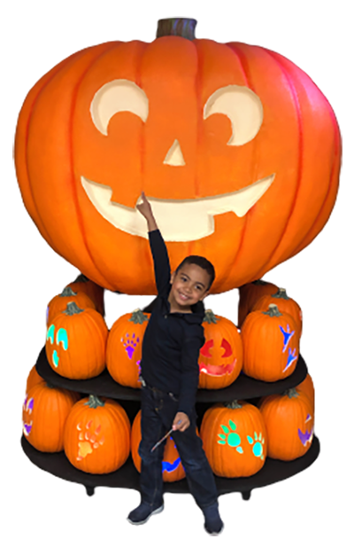 Boy with large pumpkin display