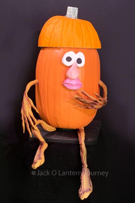 Pumpkin Baseball Player in Dugout